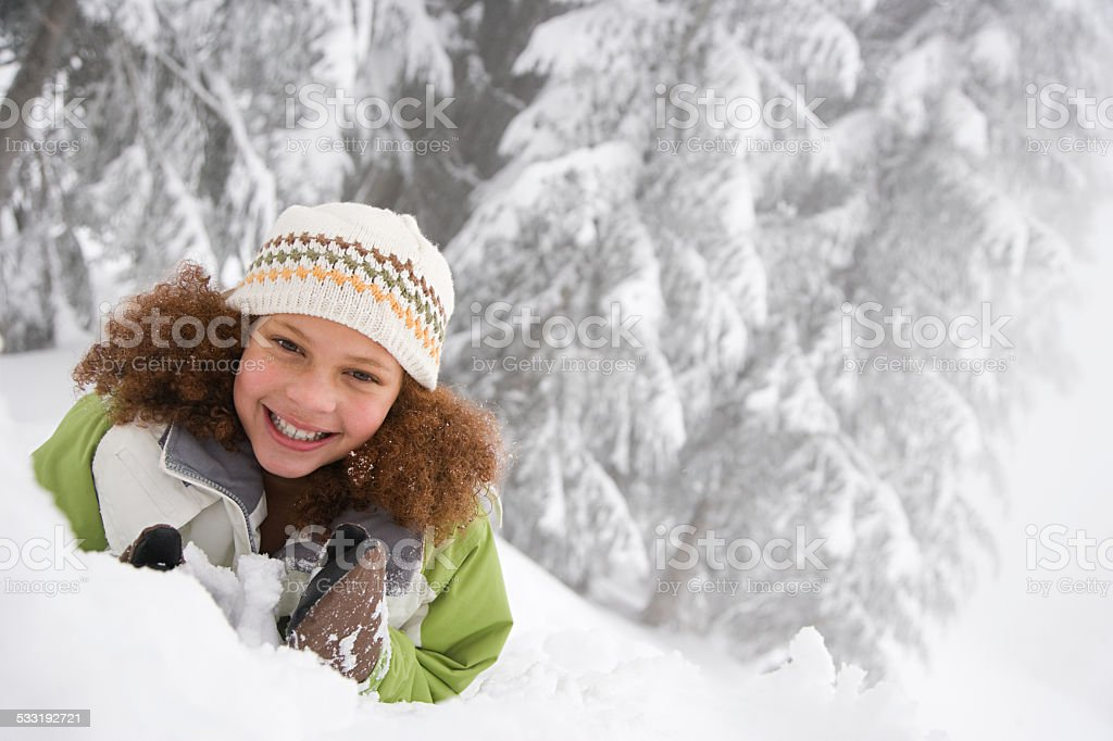 Girl in the snow stock photo