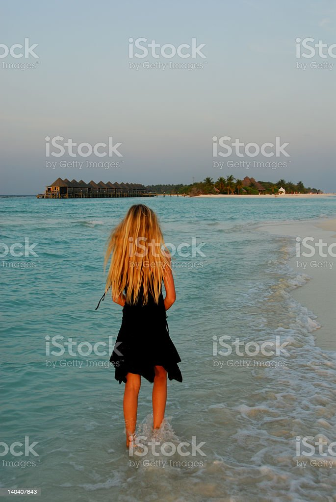 Girl in the sunset stock photo