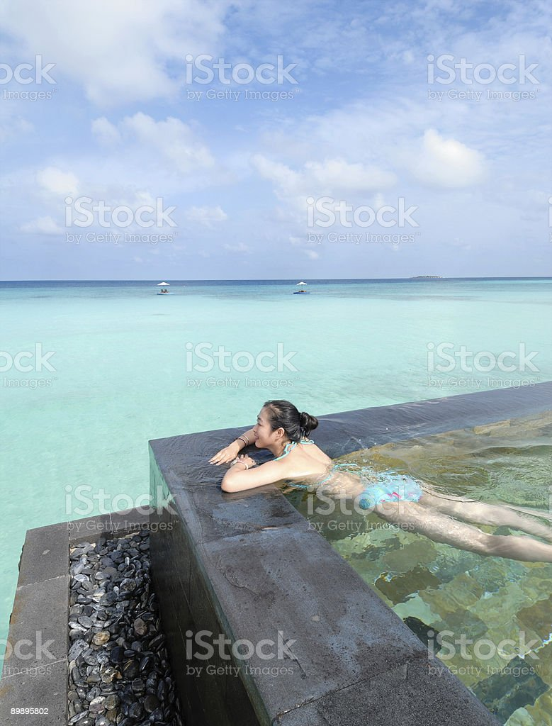 girl in the swimming pool of beach resorts royalty-free stock photo