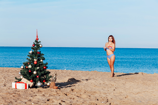 1155046257 istock photo girl in the tropics at the resort for Christmas and new year 1223387127