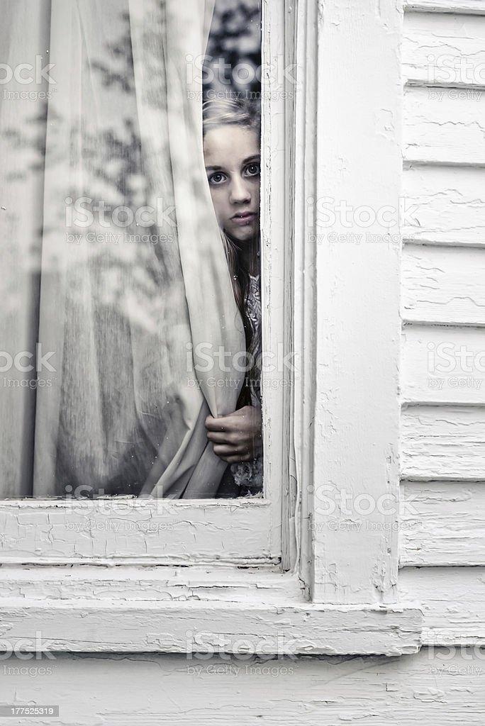 Girl in the Window stock photo