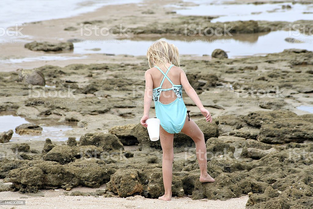 Girl in tide pool, part of a series. royalty-free stock photo