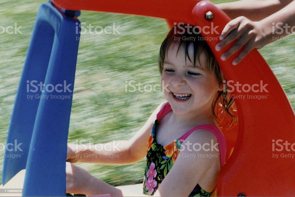 girl in toy car stock photo