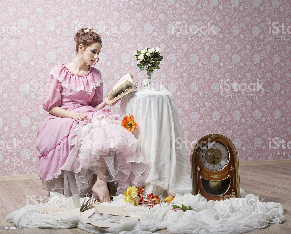 Girl in Victorian style is reading stock photo