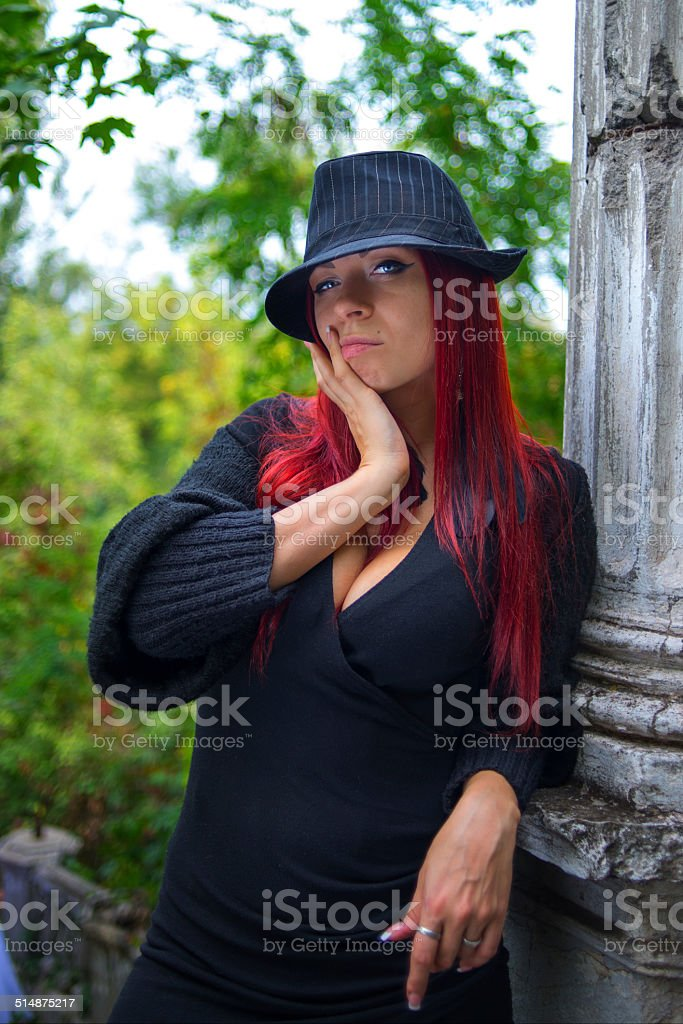 Girl in vintage clothes worth pondering in the park stock photo
