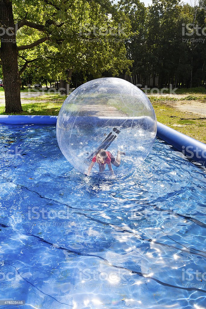 girl in water ball stock photo