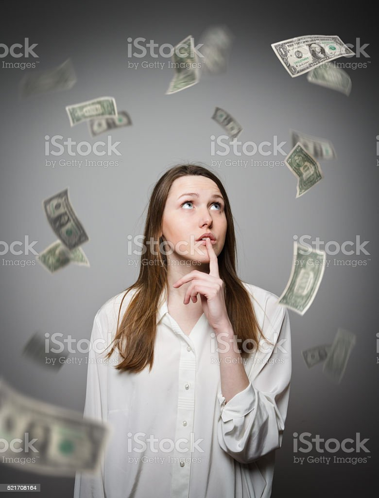 Girl in white and dollars. stock photo