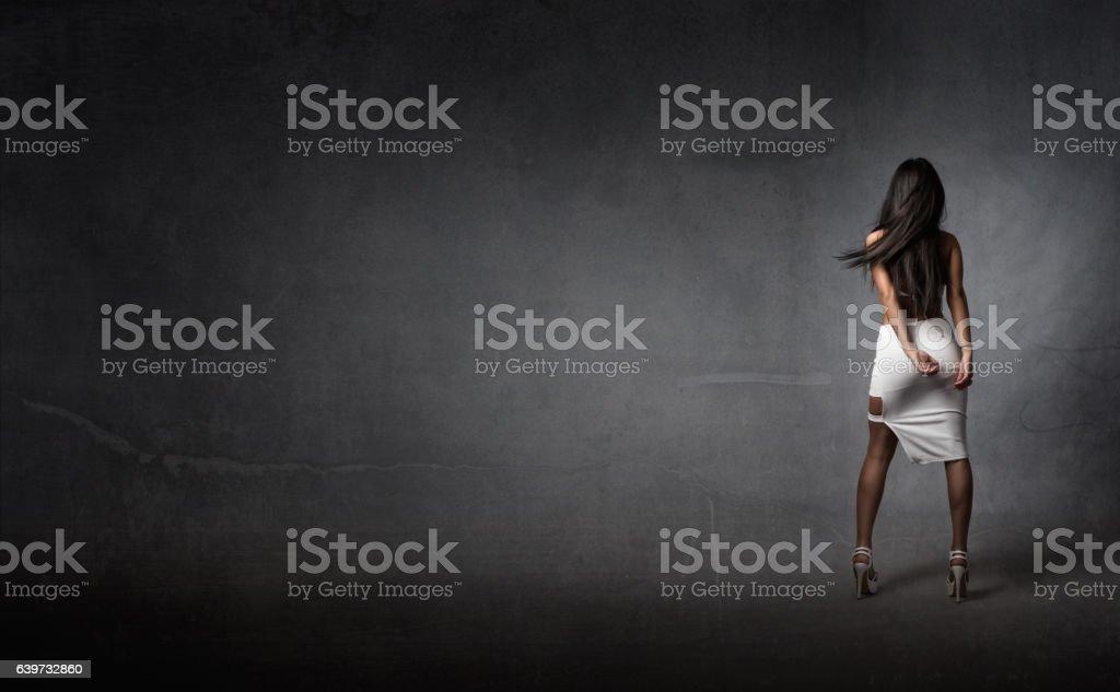 girl in white back side stock photo