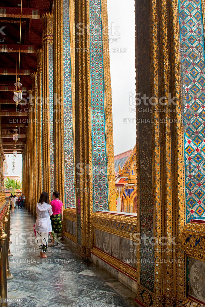Girl in white dress at The Grand Palace stock photo