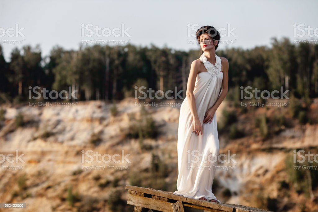 girl in white dress on a riverside royalty-free stock photo