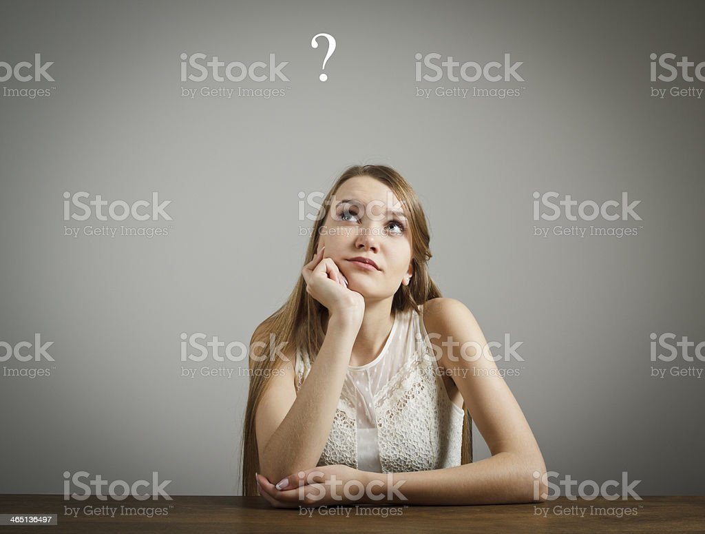 Girl in white. Question mark stock photo