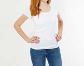 istock girl in white t-shirt isolated. Pretty smile red head woman in tshirt mock up, blank. 1253498355