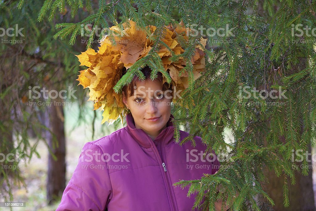 Girl In Wreath Of oranga and yellow Leaves royalty-free stock photo
