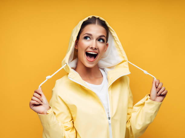 Girl in yellow raincoat stock photo