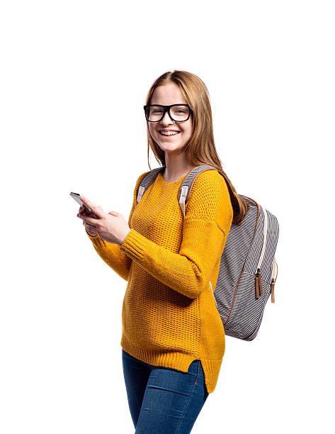 Girl in yellow sweater, holding smartphone, taking selfie, isola – Foto