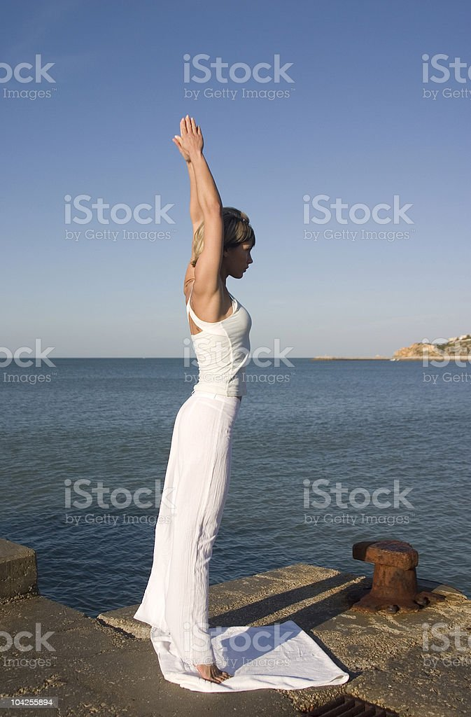 Girl in yoga position royalty-free stock photo