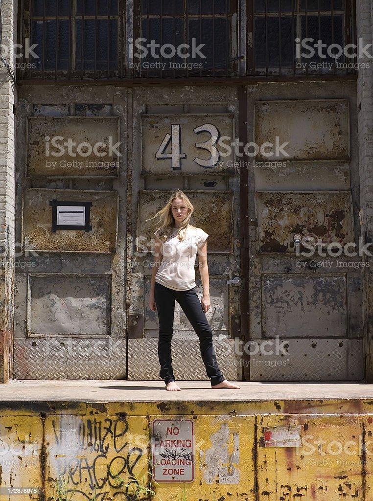 girl - industrial door royalty-free stock photo