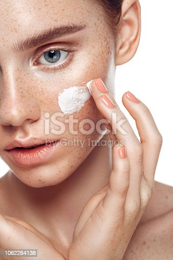 Girl inflicting cream