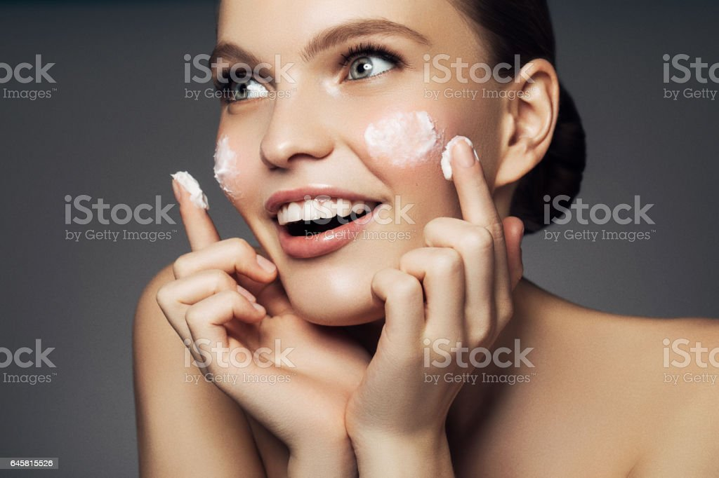 Girl inflicting cream stock photo