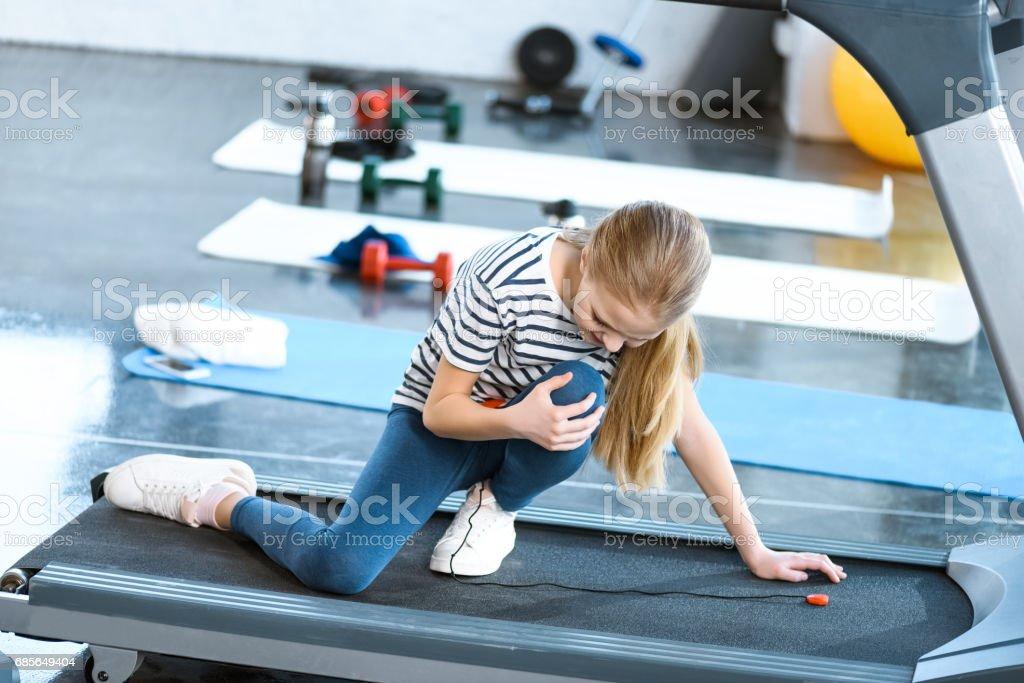 girl injured knee sitting on treadmill royalty-free 스톡 사진