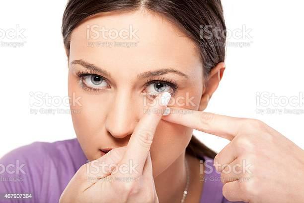 Girl inserting contact lens picture id467907364?b=1&k=6&m=467907364&s=612x612&h=y9vnzgadgzycakfyp mi5pz0la7lff0ycjz7mxy15dm=