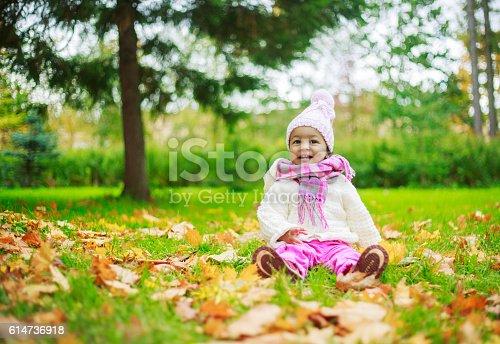 istock girl int he park 614736918