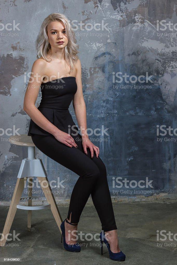Tall skinny blonde in dress