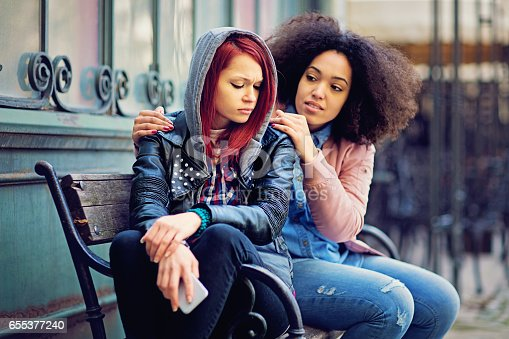 istock Girl is consoling her girlfriend after break up 655377240
