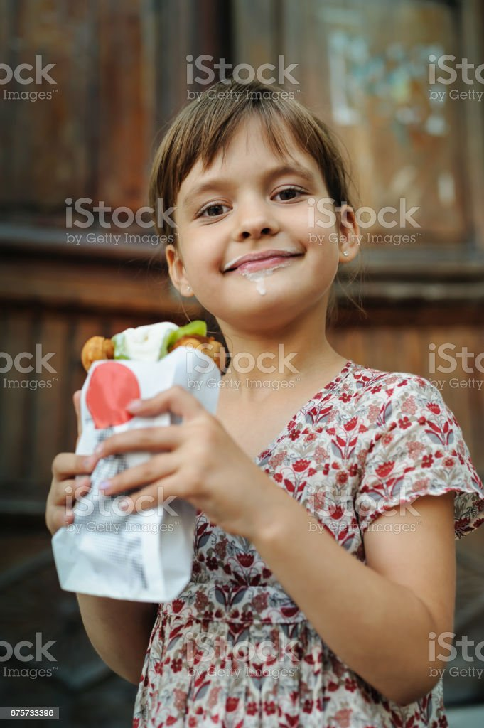 Girl is eating ice cream. – zdjęcie