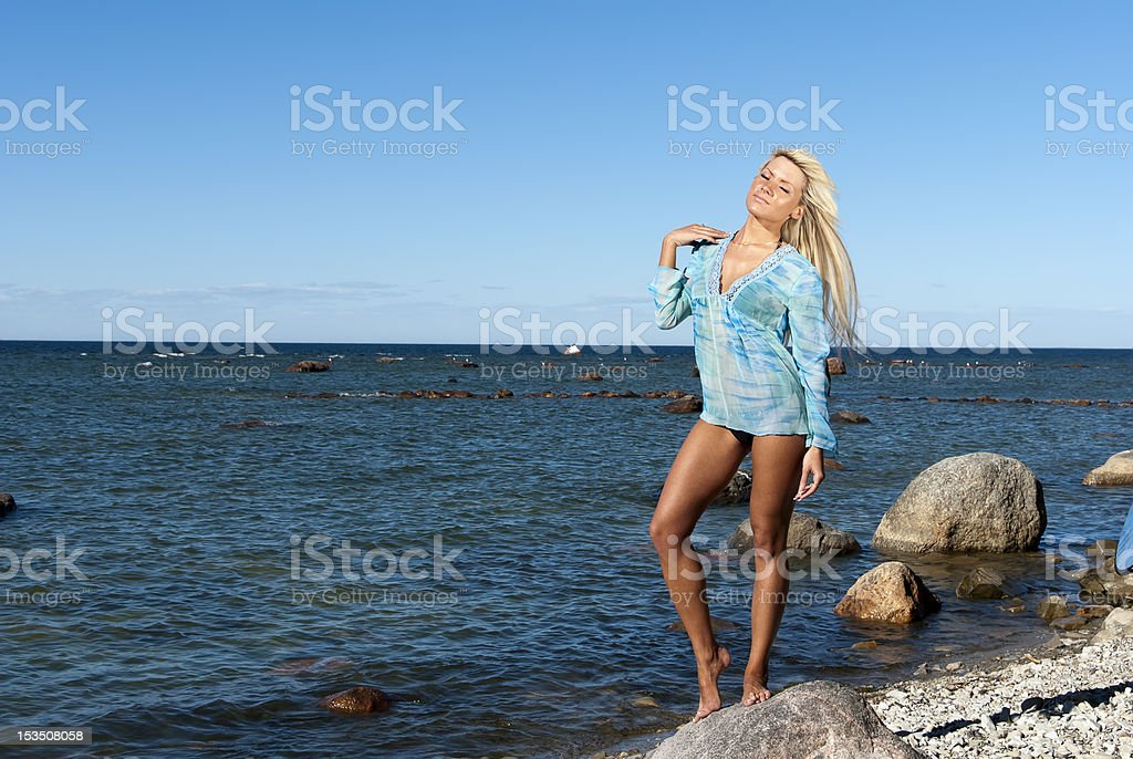 girl is enjoying summer on the beach stock photo