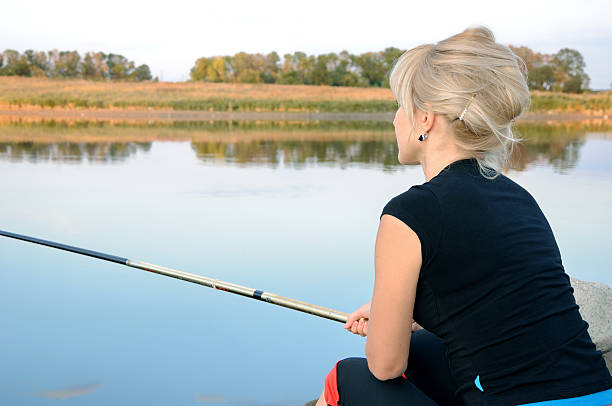 girl is fishing - hair line surface stock photos and pictures