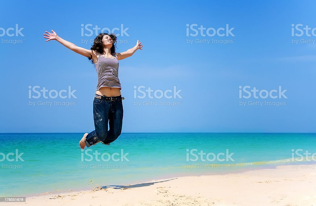 Girl is having fun on the beautiful tropical beach. stock photo