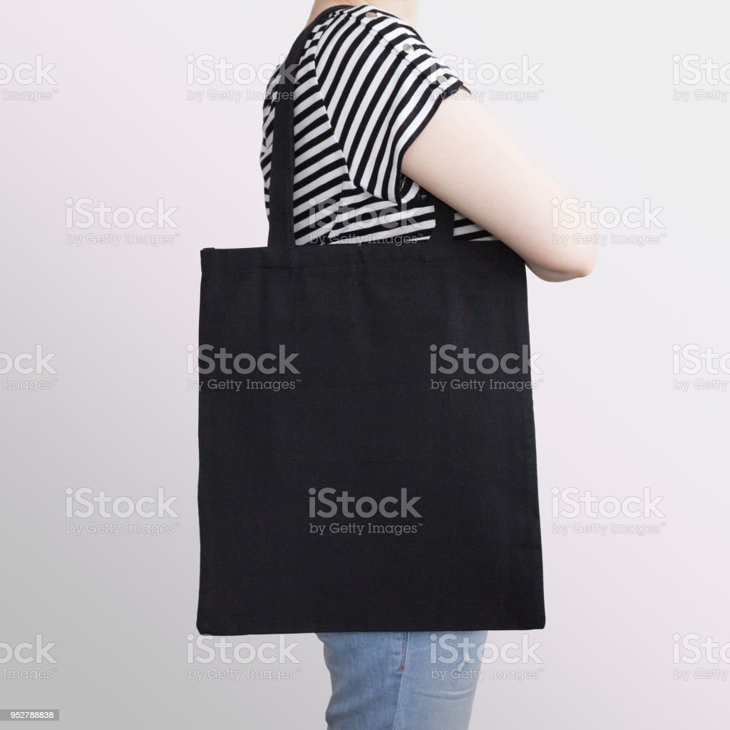 Girl is holding black cotton eco tote bag, design mockup. stock photo