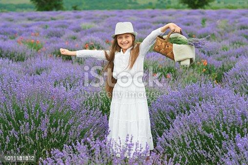 girl is in the lavender field, beautiful portrait, white dress, summer landscape
