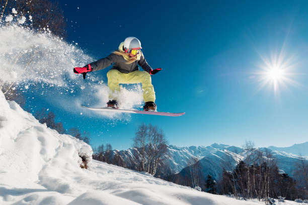 Girl is jumping with snowboard picture id959512078?b=1&k=6&m=959512078&s=612x612&w=0&h=7jph2ttaw pknuiamatwcwfkv2x4zz7lob50 ryv71w=