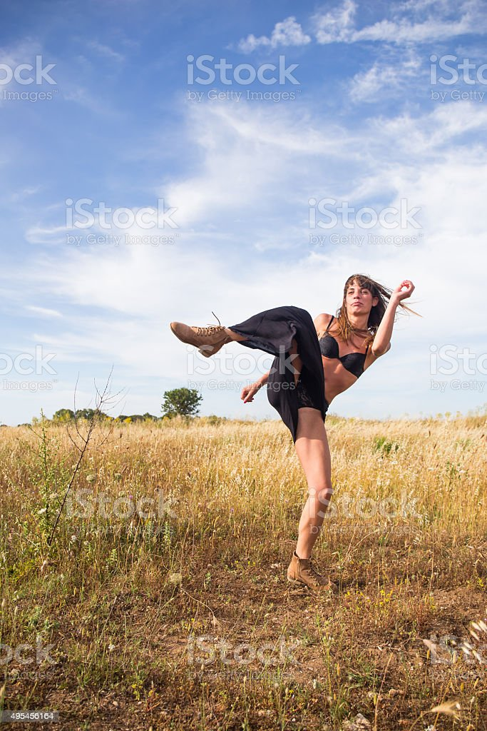 Girl is kicking in countryside stock photo