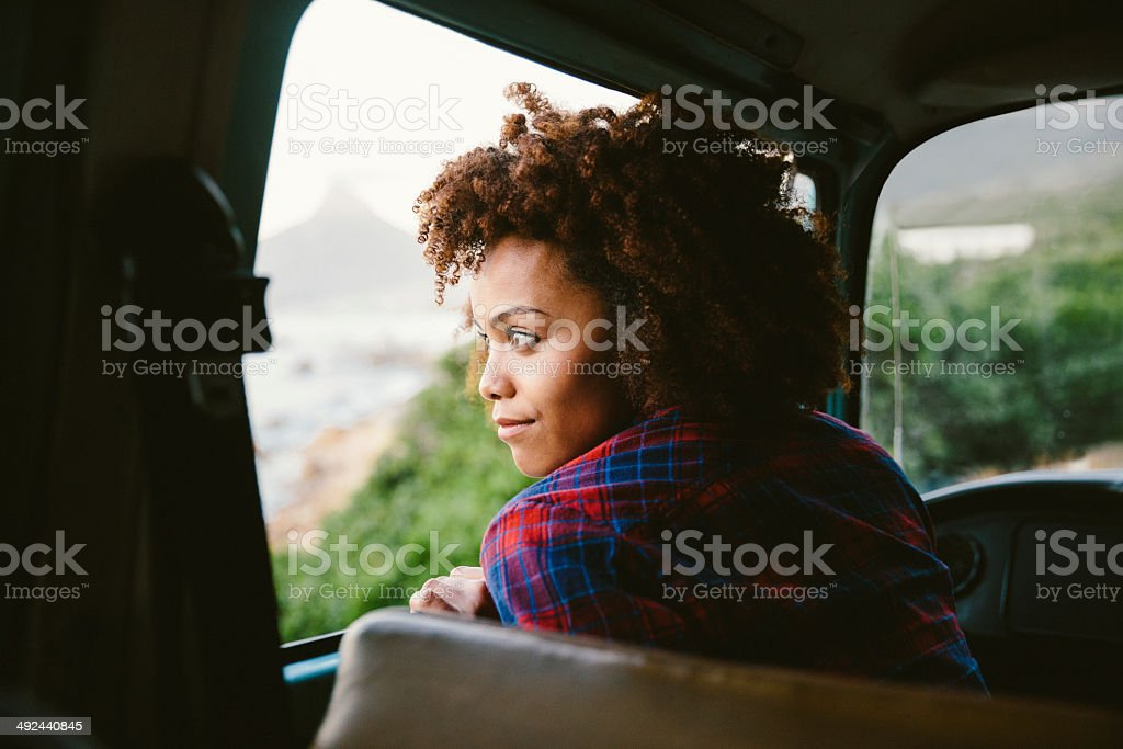 Girl is looking out of the car window stock photo