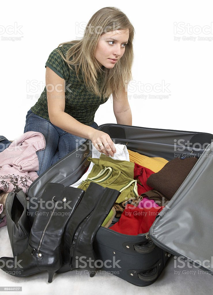 girl is packing clothes royalty-free stock photo