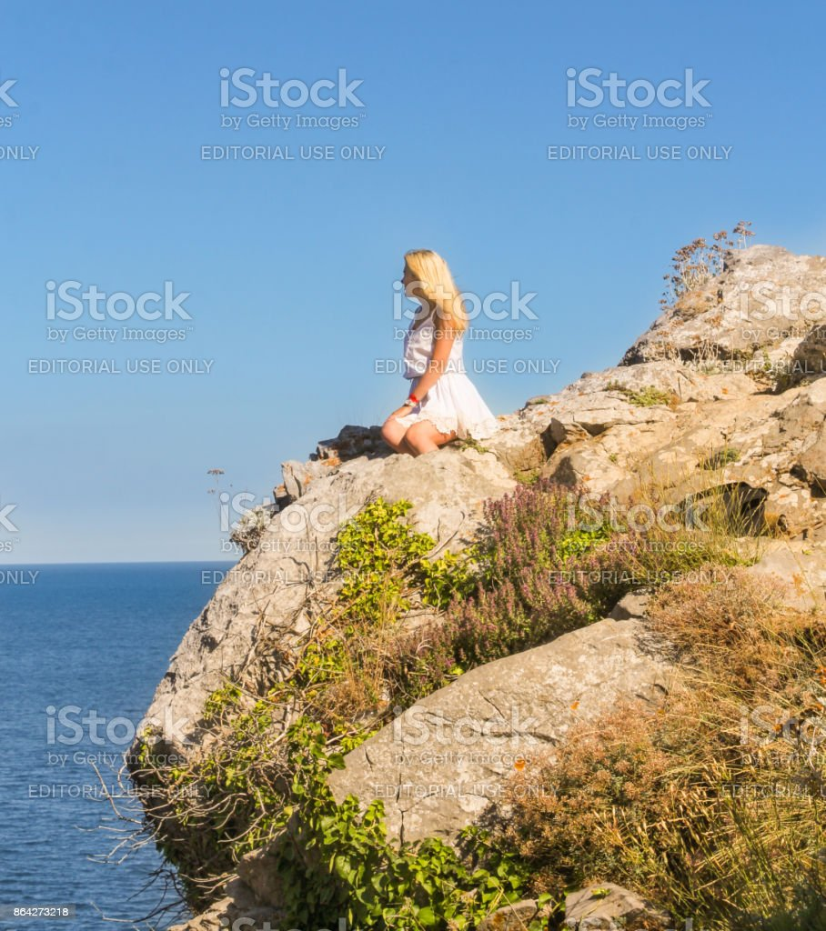 A girl is posing on a precipice. royalty-free stock photo