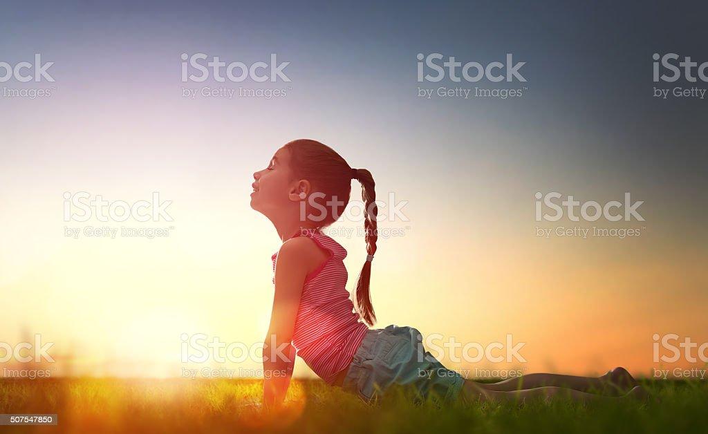 Girl is practicing yoga stock photo