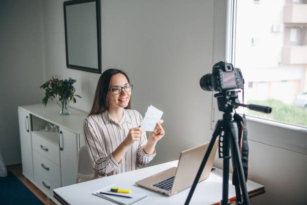a girl is recording an instructional video. - side hustle stock pictures, royalty-free photos & images