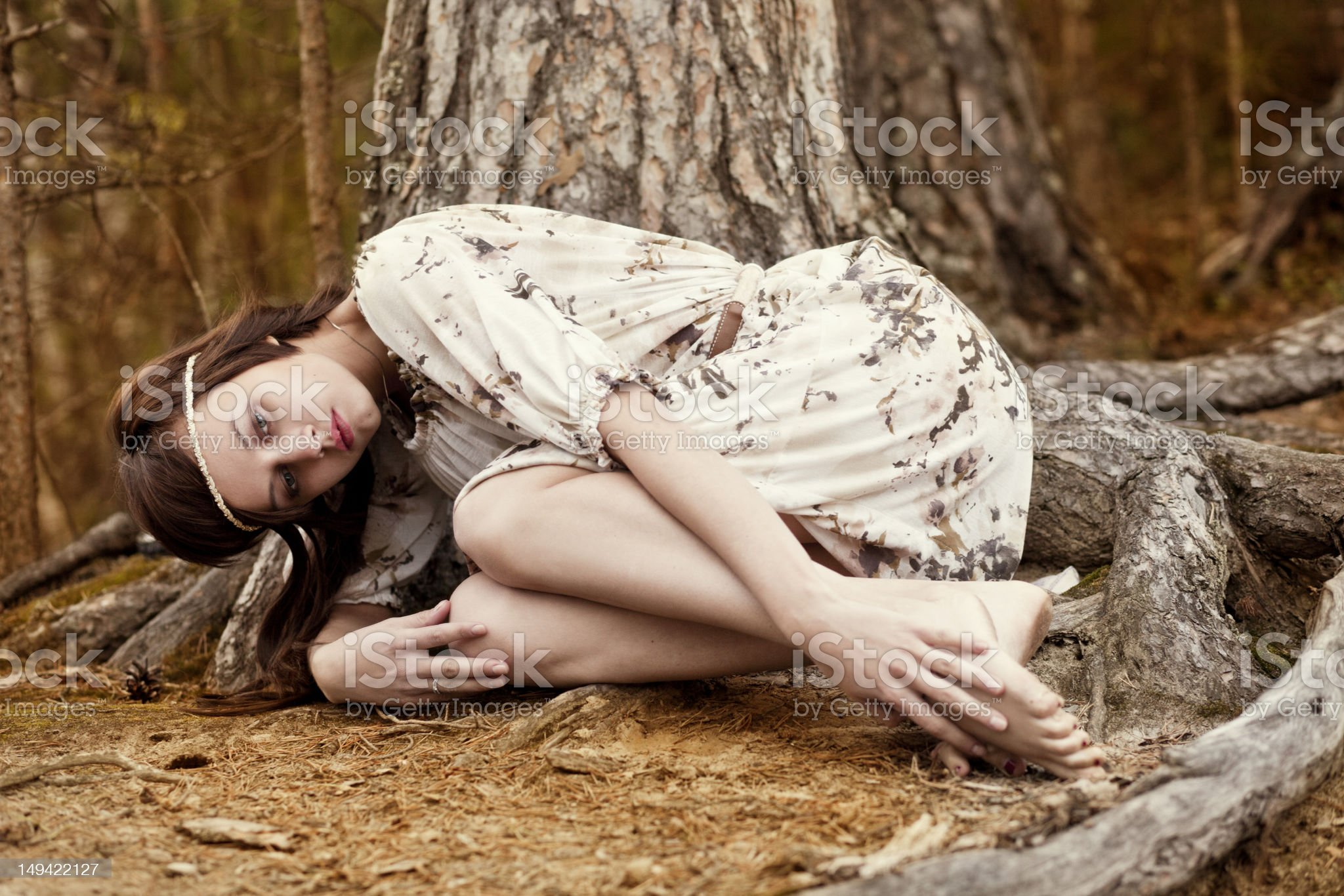 https://media.istockphoto.com/photos/girl-is-relaxing-under-tree-picture-id149422127?s=2048x2048