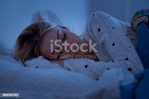 istock Girl is sleeping with her face on the pillow 996080482