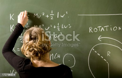 istock Girl is solving a mathematical problem on blackboard 172798224