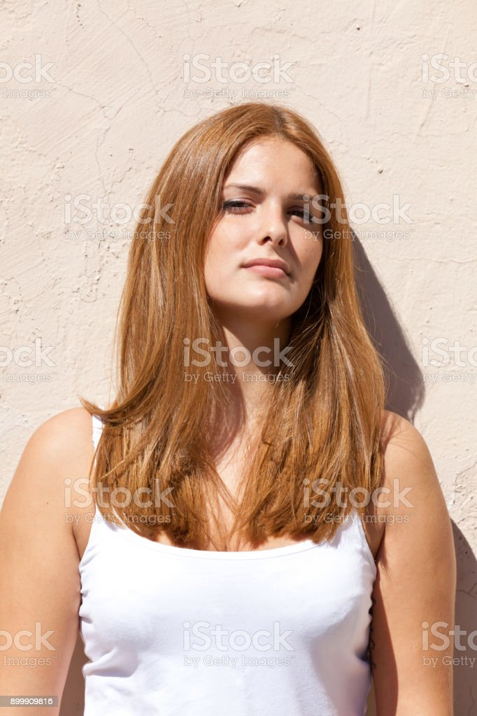 Girl is standing on the wall stock photo