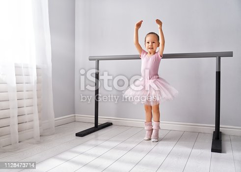 istock girl is studying ballet. 1128473714