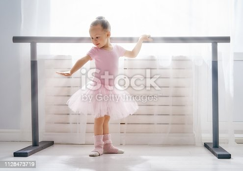 istock girl is studying ballet. 1128473719