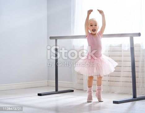 istock girl is studying ballet. 1128473721