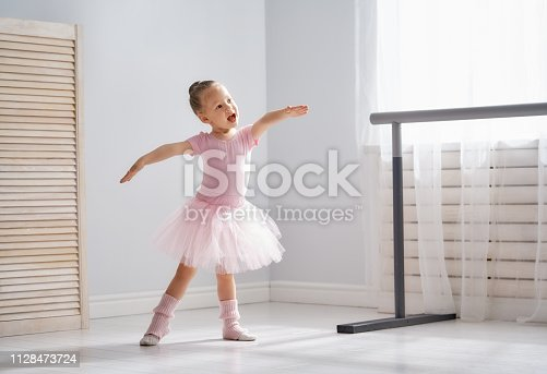 istock girl is studying ballet. 1128473724