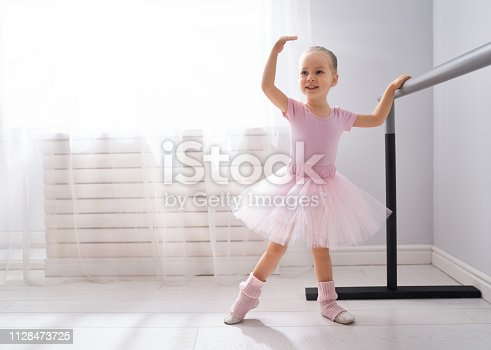 istock girl is studying ballet. 1128473725